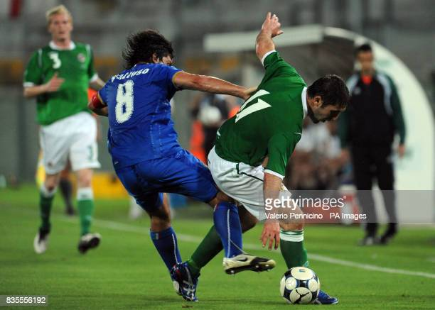 Italy's Ivan Gennaro Gattuso and Northern Ireland's Stephen Carson in action during the International Friendly at the Arena Garibaldi Stadium Pisa...