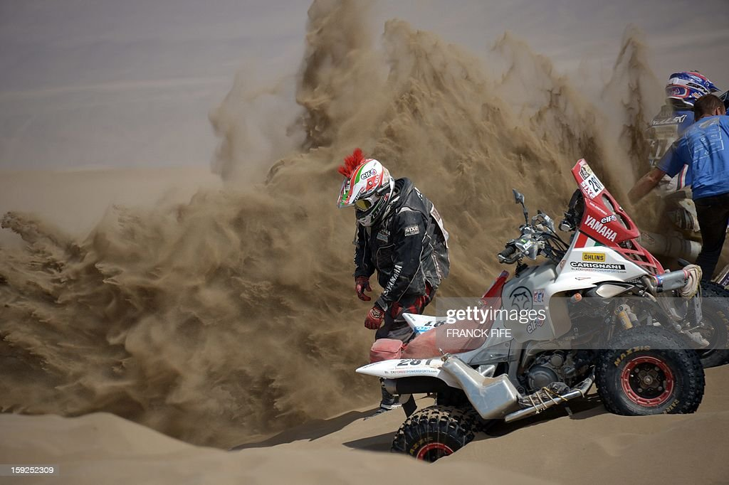 Italy's Juan Carlos Carignani is pictured during the Stage 6 of the 2013 Dakar Rally between Arica and Calama, Chile, on January 10, 2013. The rally is taking place in Peru, Argentina and Chile from January 5 to 20.