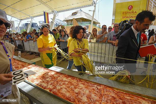 Italy's judge of the 'Guinness World Record' Lorenzo Veltri measures the length of the Pizza to be the longest in the world with 1600m long on June...