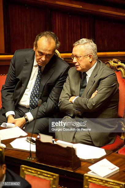 Italy's Justice minister Nitto Palma and Finance minister Giulio Tremonti talk during the vote on the 2012 Budget Law at the Senate on November 11...