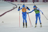 Italy's Karin Oberhofer hands over to team mate Dominik Windisch as they compete in the Biathlon mixed 2x6 km 2x75 km Relay at the Laura CrossCountry...
