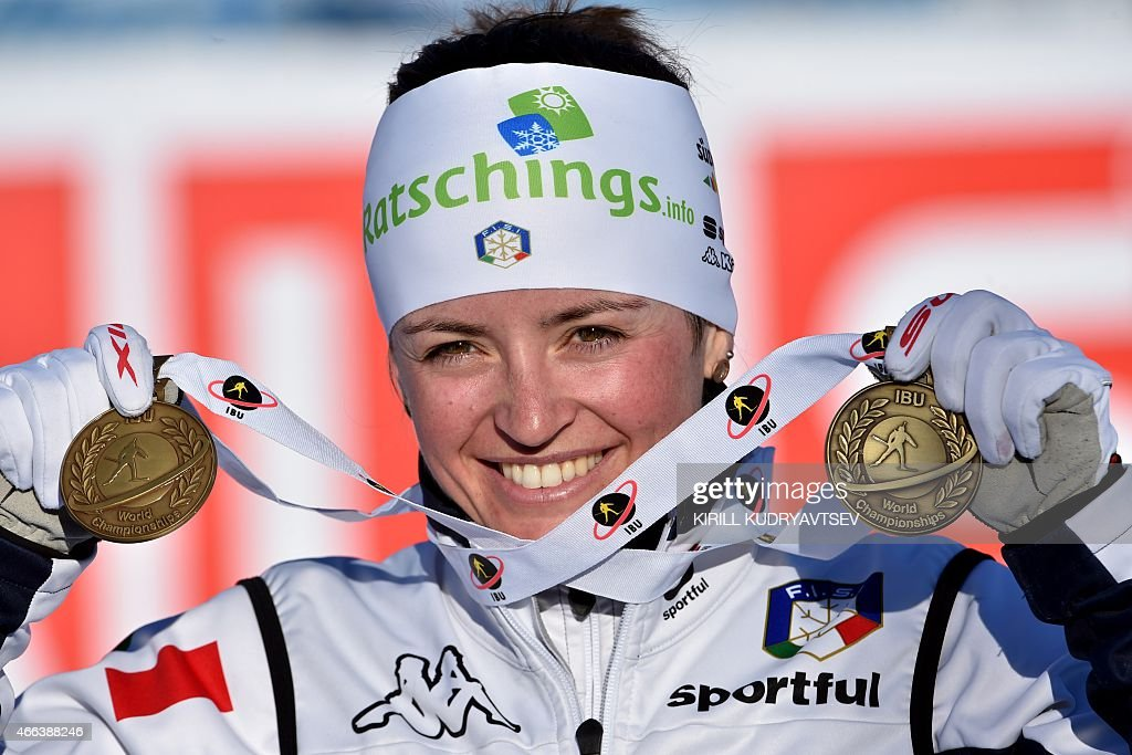 Italy's <a gi-track='captionPersonalityLinkClicked' href=/galleries/search?phrase=Karin+Oberhofer&family=editorial&specificpeople=6690558 ng-click='$event.stopPropagation()'>Karin Oberhofer</a> shows her championship medals after the Women 12,5 km Mass Start at the IBU Biathlon World Championship in Kontiolahti, Finland on March 15, 2015. Ukraine's Valj Semerenko won the competition, Germany's Franziska Preuss placed second and Italy's <a gi-track='captionPersonalityLinkClicked' href=/galleries/search?phrase=Karin+Oberhofer&family=editorial&specificpeople=6690558 ng-click='$event.stopPropagation()'>Karin Oberhofer</a> placed third. AFP PHOTO / KIRILL KUDRYAVTSEV