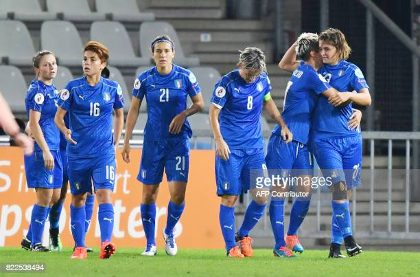 Italy's Katja Schroffenegger celebrates with teammates after scoring Italy's third goal during the UEFA Women's Euro 2017 football match between...