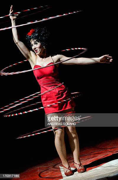 Italy's Laisa Di Lello juggler of Rony Roller's Circus performs with her Betty Boop's hulahop during the show in a suburb of Rome on June 7 as part...