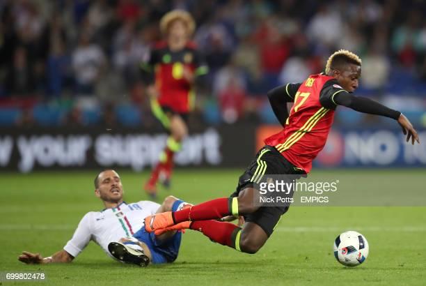 Italy's Leonardo Bonucci and Belgium's Divock Origi battle for the ball