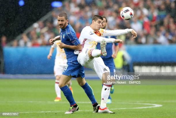 Italy's Leonardo Bonucci and Spain's Alvaro Morata battle for the ball