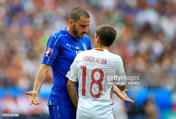 Italy's Leonardo Bonucci argues with Spain's Jordi Alba