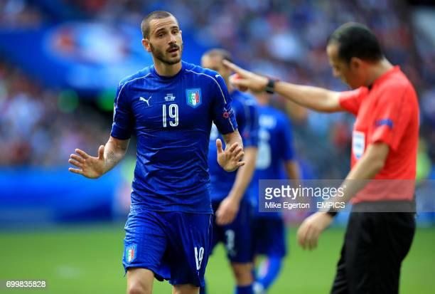 Italy's Leonardo Bonucci is penalised by referee Cuneyt Cakir