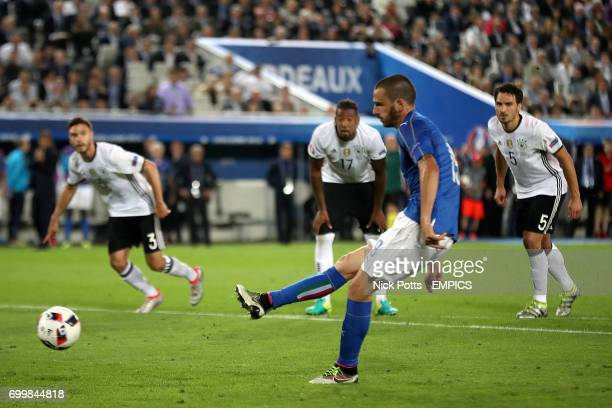 Italy's Leonardo Bonucci scores their first goal from the penalty spot