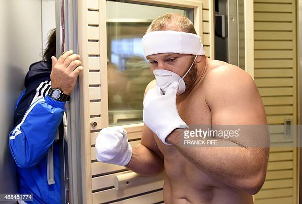 Italy's Leonardo Ghiraldini exits a cryotherapy chamber after a recovery session at the University of Surrey in Guildford south England on September...