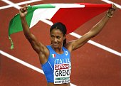 Italy's Libania Grenot celebrates after winning the 400m during the European Athletics Championships at the Olympic Stadium in Amsterdam on July 8...
