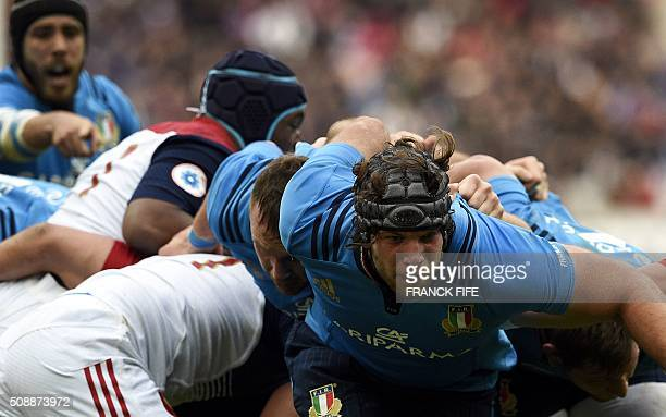 TOPSHOT Italy's lock Marco Fuser is tackled during the Six Nations international rugby union match between France and Italy at the Stade de France in...