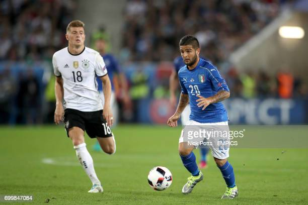 Italy's Lorenzo Insigne and Germany's Toni Kroos in action