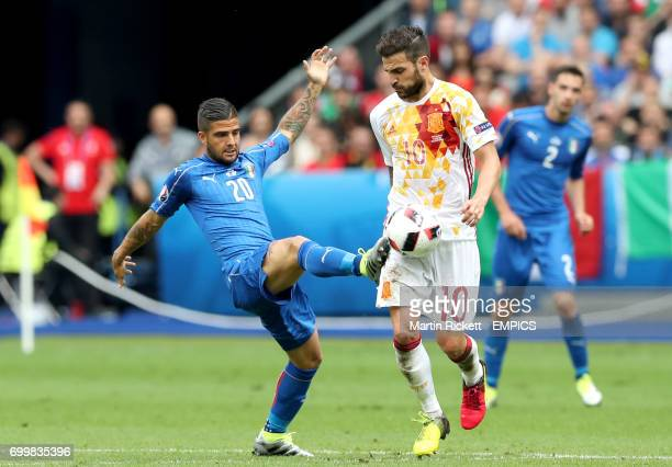 Italy's Lorenzo Insigne and Spain's Cesc Fabregas battle for the ball