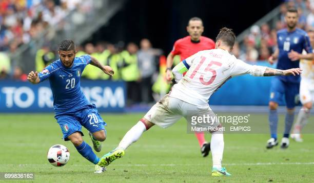 Italy's Lorenzo Insigne and Spain's Sergio Ramos battle for the ball
