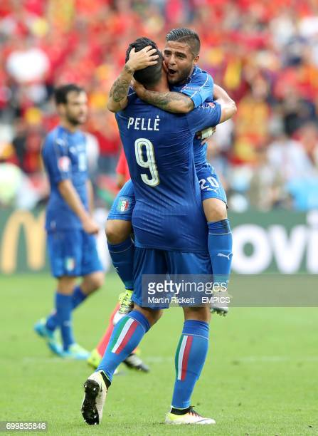 Italy's Lorenzo Insigne celebrates with teammate Graziano Pelle after the final whistle