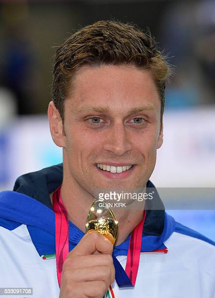 Italy's Luca Dotto poses with his gold medal after winning the Men's 100m Freestyle Final event at the European Aquatics Championships in London on...
