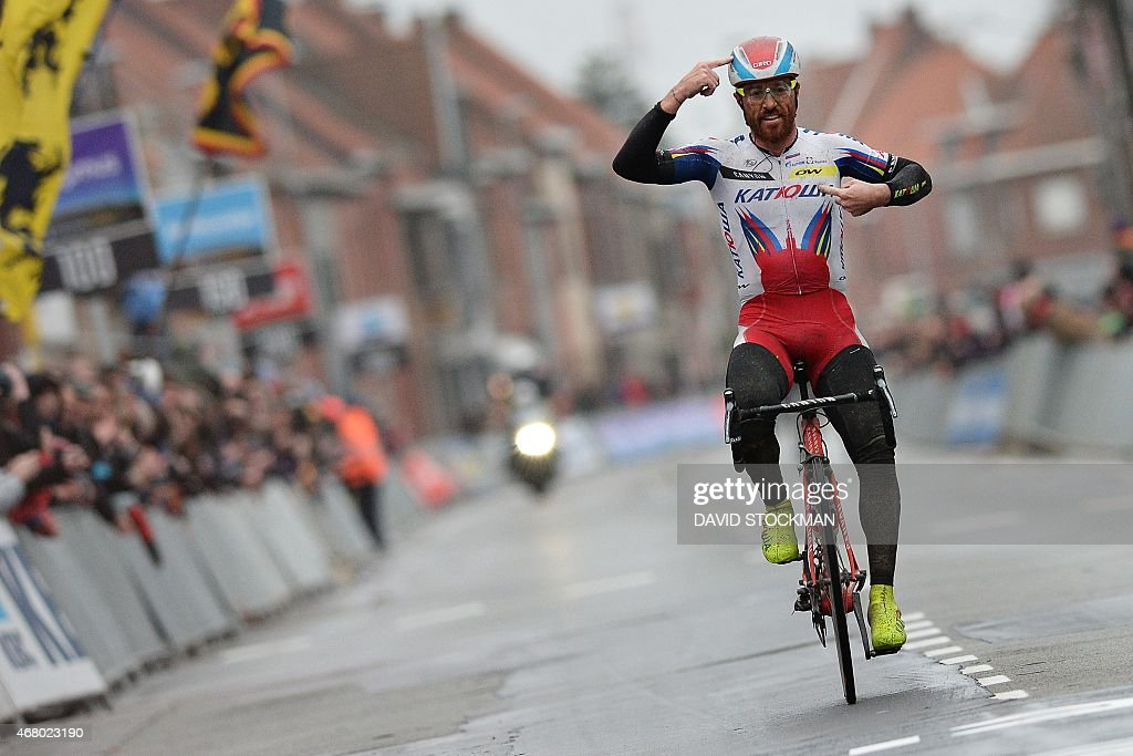 Italy's <a gi-track='captionPersonalityLinkClicked' href=/galleries/search?phrase=Luca+Paolini&family=editorial&specificpeople=774515 ng-click='$event.stopPropagation()'>Luca Paolini</a> of Team Katusha celebrates as he crosses the finish-line to win the 77th edition of the Gent-Wevelgem one-day cycling race from Deinze to Wevelgem on March 29, 2015. AFP PHOTO / BELGA / DAVID STOCKMAN OUT ==