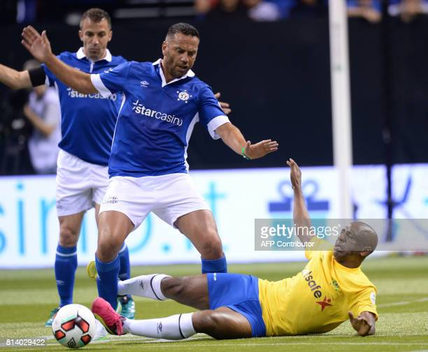 Italy's Luciano Zauri vies with Brazil's Djalminha during the Star Sixes football match between Brazil and Italy at the O2 Arena in London on July 13...