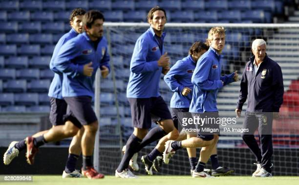 Italy's manager Marcello Lippi watches his team during a training session at Hampden Park Glasgow Friday September 2 2005 Italy play Scotland in a...