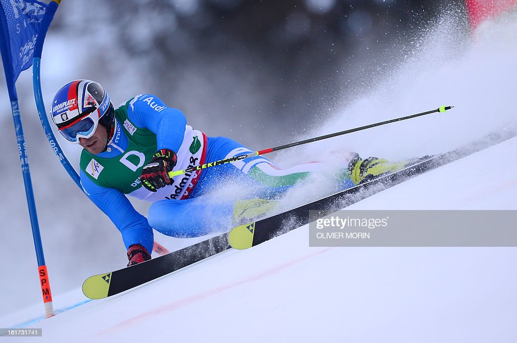 Italy's Manfred Moelgg skis during the first run of the men's Giant slalom at the 2013 Ski World Championships in Schladming, Austria on February 15, 2013. AFP PHOTO / OLIVIER MORIN