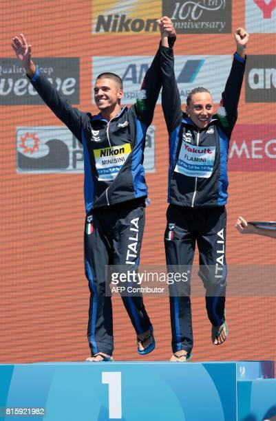 Italy's Manila Flamini and Italy's Giorgio Minisini celebrate their victory during the podium ceremony for the Mixed Duet technical final during the...