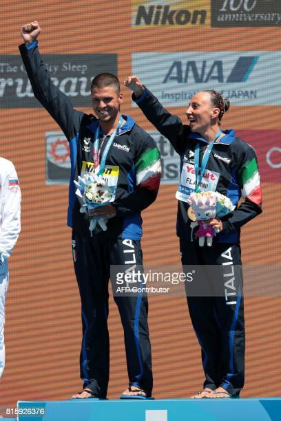 Italy's Manila Flamini and Italy's Giorgio Minisini celebrate winning the gold medal during the podium ceremony for the Mixed Duet technical final...