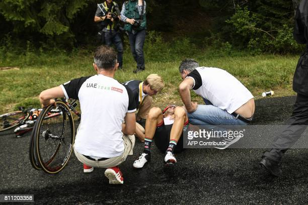 Italy's Manuele Mori receives medical assistance after falling during the 1815 km ninth stage of the 104th edition of the Tour de France cycling race...