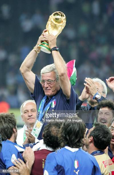 Italy's Marcelo Lippi celebrates with the trophy