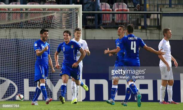 Italy's Marco Benassi celebrates scoring his side's third goal of the game with teammates