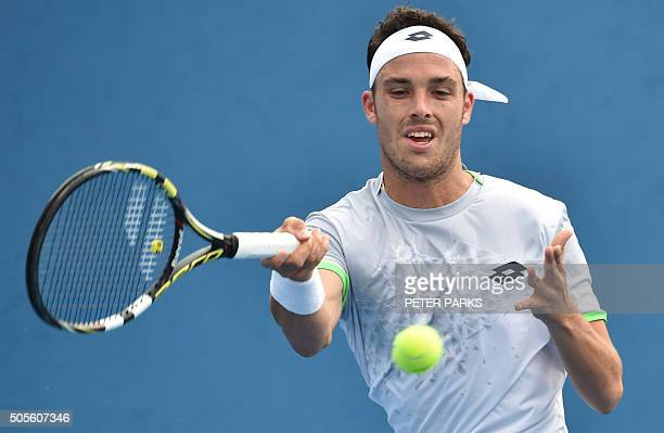 Italy's Marco Cecchinato plays a forehand return during his men's singles match against France's Nicolas Mahut on day two of the 2016 Australian Open...