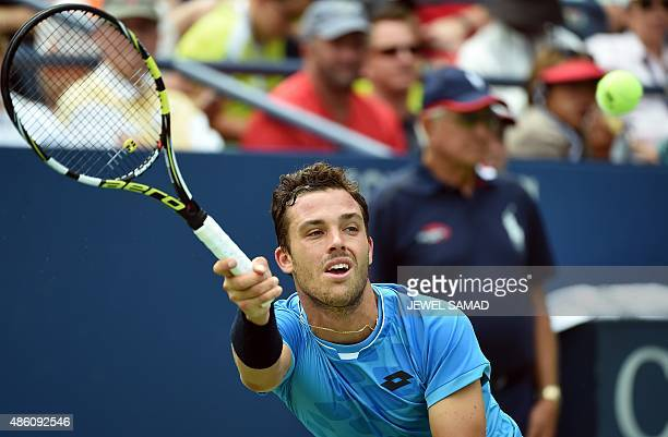 Italy's Marco Cecchinato returns a shot to Mardy Fish of the US during their 2015 US Open Mens Singles round 1 match at USTA Billie Jean King...