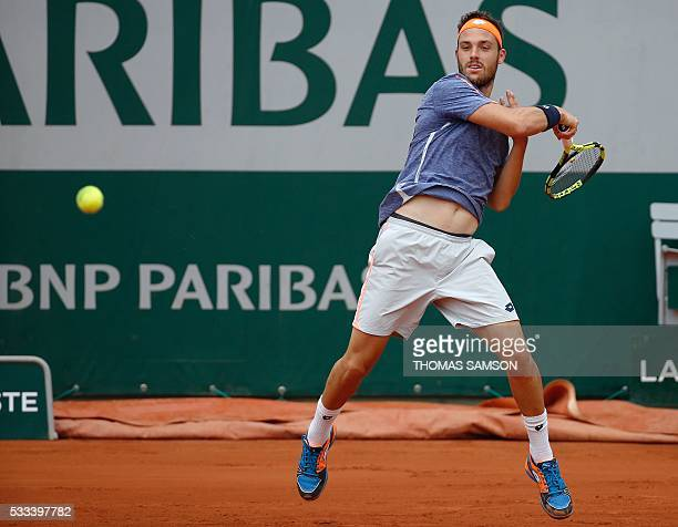 Italy's Marco Cecchinato returns the ball to Australia's Nick Kyrgios during their men's first round match at the Roland Garros 2016 French Tennis...