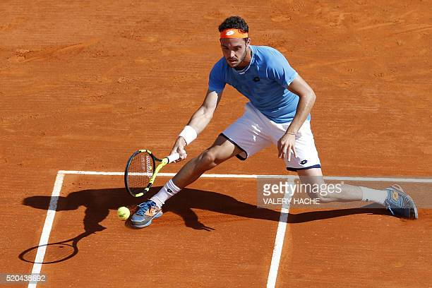 Italy's Marco Cecchinato returns the ball to Canada's Milos Raonic during the MonteCarlo ATP Masters Series Tournament on April 11 2016 in Monaco...