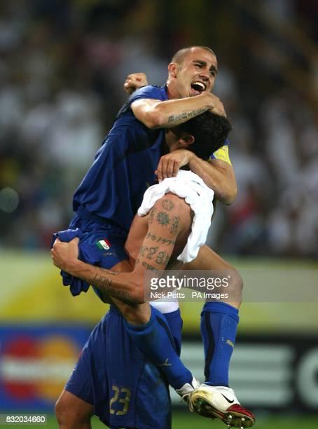Italy's Marco Materazzi and Fabio Cannavaro celebrate their win