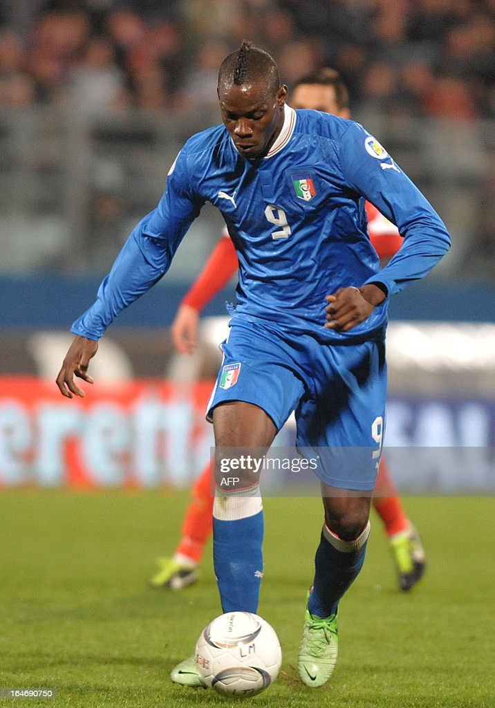 Italy's Mario Balotelli controls the ball during the FIFA 2014 World Cup qualifying football match Malta vs.Italy at the National Stadium in Malta on March 26, 2013.