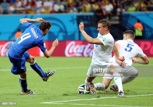Italy's Matteo Darmian has his shot blocked by England's Gary Cahill and Phil Jagielka during the FIFA World Cup Group D match at the Arena da...