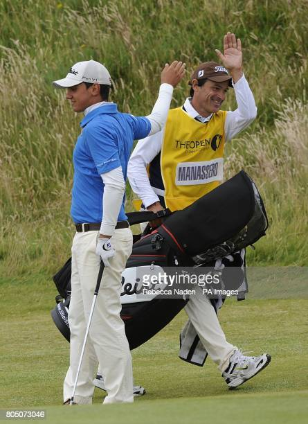 Italy's Matteo Manassero celebrates with his caddie during the second day of the Open Championship at Turnberry Golf Club