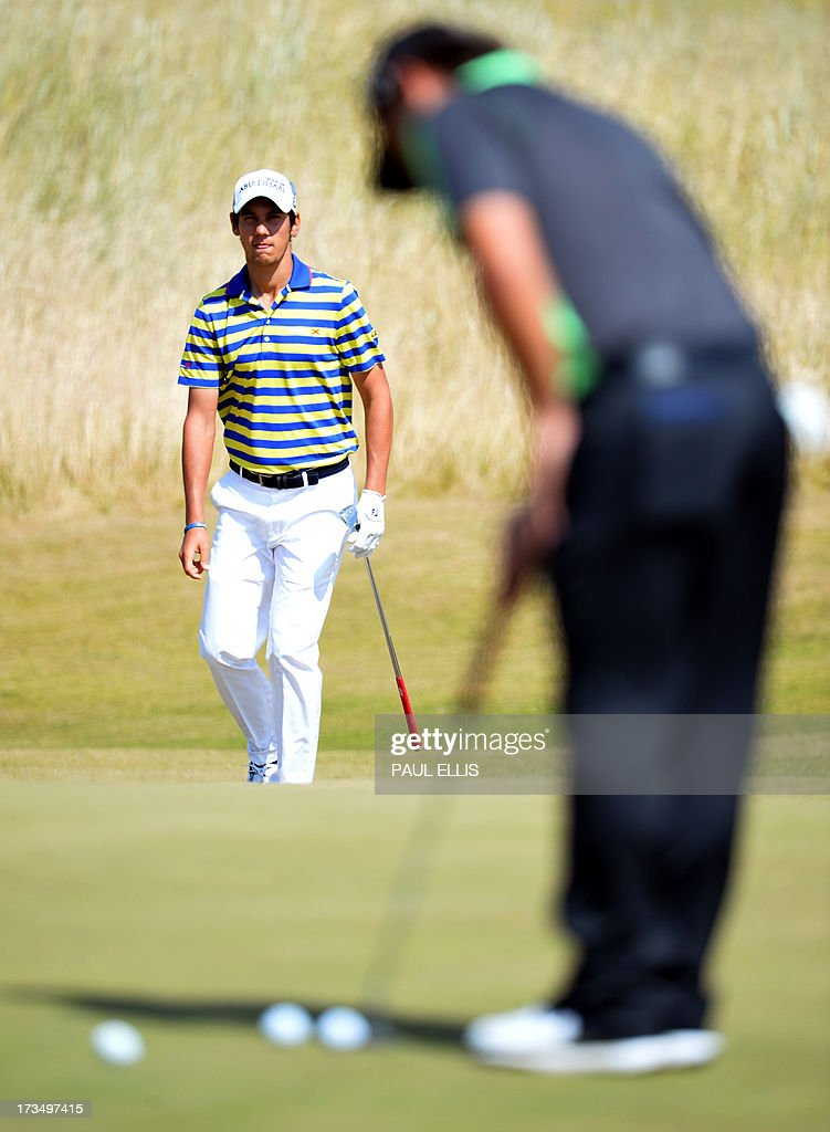 Italy's Matteo Manassero (L) plays onto the seventh green at Muirfield golf course at Gullane in Scotland on July 15, 2013 ahead of The 2013 Open Golf Championship. AFP PHOTO/Paul Ellis