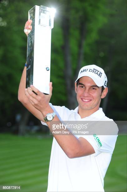 Italy's Matteo Manassero with the BMW PGA Championship trophy during day four of the BMW PGA Championship at the Wentworth Club Surrey