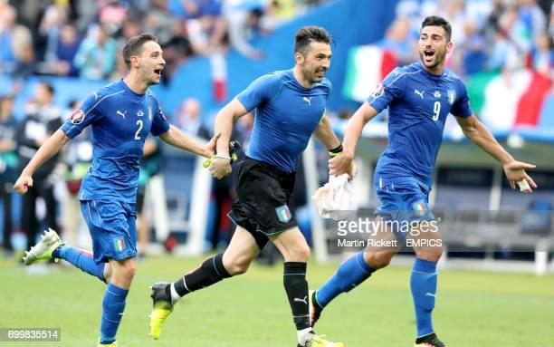 Italy's Mattia De Sciglio goalkeeper Gianluigi Buffon and Graziano Pelle celebrate victory after the match