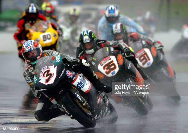 Italy's Max Biaggi leads Great Britain's Cal Crutchlow and Leon Haslam through the spray around the Esses during race two of the SBK World Superbikes...