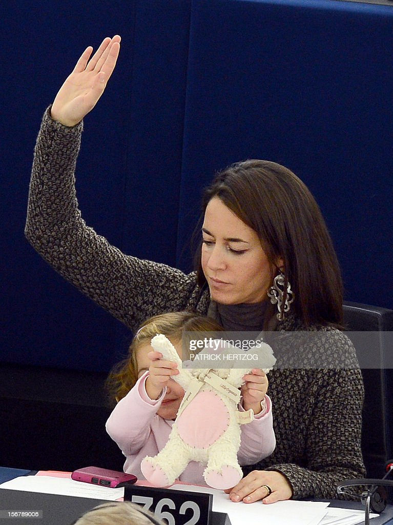 Italy's Member of the European Parliament Licia Ronzulli takes part with her daughter Victoria in a vote during a plenary session of the European parliament on two initiative reports on shale gas, in Strasbourg, eastern France, on November 21, 2012. AFP PHOTO / PATRICK HERTZOG