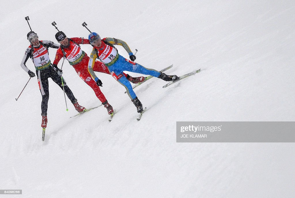 Italy's Michaela Ponza Czech's Zdenka Vejnarova and Ukraine's Vita Semerenko compete in women's 75 km sprint during biathlon World Cup in Hochfilzen...