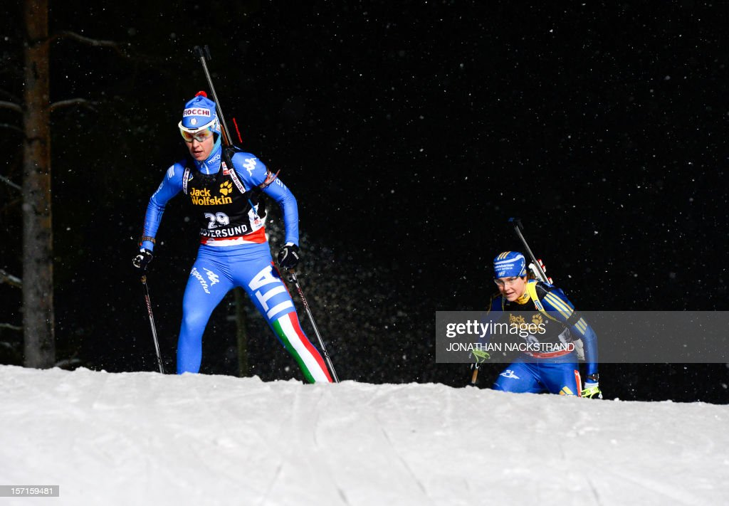 Italy's Michela Ponza and Sweden's AnnaKarin Stroemstedt compete during the women's 15 km individual race of the Biathlon World Cup in Ostersund on...
