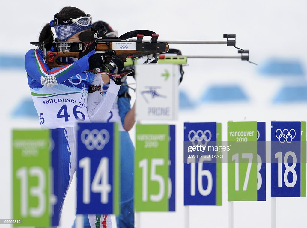 Italy's Michela Ponza competes in the women's 75km Sprint Biathlon at the Whistler Olympic Park during the Vancouver Winter Olympics on February 13...
