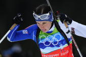 Italy's Michela Ponza competes in the women's Biathlon 4x6 km relay at the Whistler Olympic Park during the Vancouver Winter Olympics on February 23...