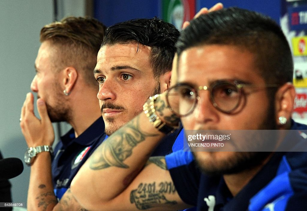 Italy's midfielder Alessandro Florenzi (C), Italy's forward Ciro Immobile (L) and Italy's forward Lorenzo Insigne during a press conference following a training session at their training ground in Montpellier on June 29, 2016 during the Euro 2016 football tournament. / AFP / VINCENZO