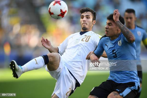 Italy's midfielder Alfredo Bifulco compete for the ball next to Uruguay's defender Mathias Olivera during the U20 World Cup third place playoff...
