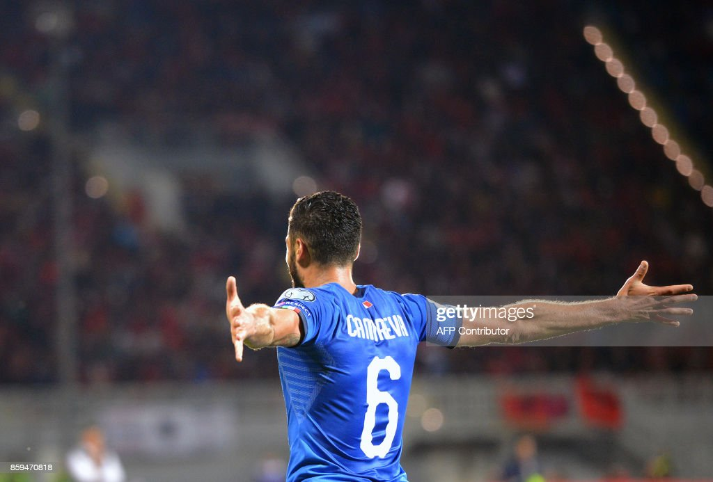 Italy's midfielder Antonio Candreva celebrates after scoring a goal during the FIFA World Cup 2018 qualification football match between Albania and Italy at Loro Borici Stadium in Shkoder on October 9, 2017. / AFP PHOTO / Dimitar DILKOFF